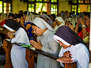 19 NOVEMBER 2017 - HWAMBI, YANGON REGION, MYANMAR: Nuns pray during mass in Sacred Heart's Catholic Church in Hwambi, about 90 minutes north of Yangon. Catholics in Myanmar are preparing for the visit of Pope Francis. He is coming to the Buddhist majority country November 27-30. There about 500,000 Catholics in Myanmar, about 1% of the population. Catholicism was originally brought to what is now Myanmar more than 500 years ago by Portuguese missionaries and traders.    PHOTO BY JACK KURTZ