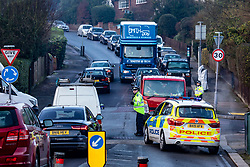 © Licensed to London News Pictures. 21/01/2020. London, UK. Police close roads after a body was found in Durnsford Road Wimbledon SW19. Photo credit: Alex Lentati/LNP