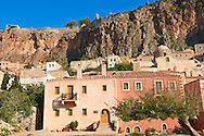 Houses of Monemvasia (  ) Byzantine Island catsle town with acropolis on the plateau.   Peloponnese, Greece ..<br /> <br /> Visit our GREEK HISTORIC PLACES PHOTO COLLECTIONS for more photos to download or buy as wall art prints https://funkystock.photoshelter.com/gallery-collection/Pictures-Images-of-Greece-Photos-of-Greek-Historic-Landmark-Sites/C0000w6e8OkknEb8 <br /> .<br /> <br /> Visit our MEDIEVAL PHOTO COLLECTIONS for more   photos  to download or buy as prints https://funkystock.photoshelter.com/gallery-collection/Medieval-Middle-Ages-Historic-Places-Arcaeological-Sites-Pictures-Images-of/C0000B5ZA54_WD0s