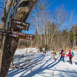Hikers begin a winter trip up Green Mountain in Effingham, New Hampshire. Libby Road Trail.