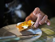 Fresh goat cheese with kumquat jam. Breakfast at Popi and Cortas's house. In and around Meronas village, Central Crete.