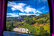 POV from a cable car high up in the trees overlooking the destination where lies another lake and a Buddhist Temple in Dalat, VN. RAW to Jpg