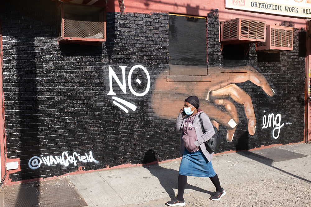 Brooklyn, NY - 22 May 2020. A new piece of street art by Ivan Cofield, a rebus that says no touching, in response to the COVID-19 social distancing recommendations. The hand reminds me of Michelangelo's Adam, in the creation of Adam scene in the Sistine Chapel.