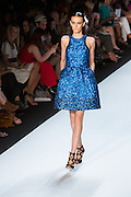 Sequined halter-top dress in electric blue. By Monique Lhuillier at Spring 2013 Fall Fashion Week in New York.