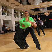 Same-sex ballroom dancers Bas Gill, right, and Martijn Diependaal of the Netherlands compete in the men's latin competition at the 5 Boro Dance Challenge on May 5, 2007...The locally produced 5 Boro Dance Challenge, New York City's first major same-sex dance competition, was held at the Park Central Hotel in Manhattan from May 4-6, 2007. .