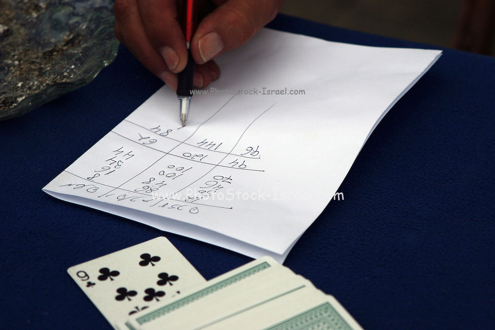 Playing Rummy tallying the score