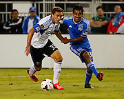 San Jose Earthquakes midfielder Rafael Baca (30) grabs onto Montreal Impact forward Andrew Wenger (33) during the first half of play at Buck Shaw Stadium in Santa Clara, California, on September 17, 2013. (Stan Olszewski/QMI Agency)
