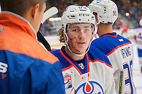 PENTICTON, CANADA - SEPTEMBER 17: Chad Butcher #65 of Edmonton Oilers is checked over by the athletic therapist at the bench against the Calgary Flames on September 17, 2016 at the South Okanagan Event Centre in Penticton, British Columbia, Canada.  (Photo by Marissa Baecker/Shoot the Breeze)  *** Local Caption *** Chad Butcher;