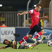 Fenerbahce's Emre Belozoglu and Arsenal's Jack Wilshere during the UEFA Champions League Play-Offs First leg soccer match Fenerbahce between Arsenal at Sukru Saracaoglu stadium in Istanbul Turkey on Wednesday 21 August 2013. Photo by TURKPIX