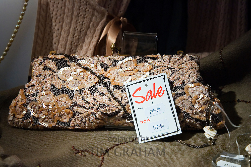 Sequinned handbag on sale in a shop in Burford in the Cotswolds, Oxfordshire, UK