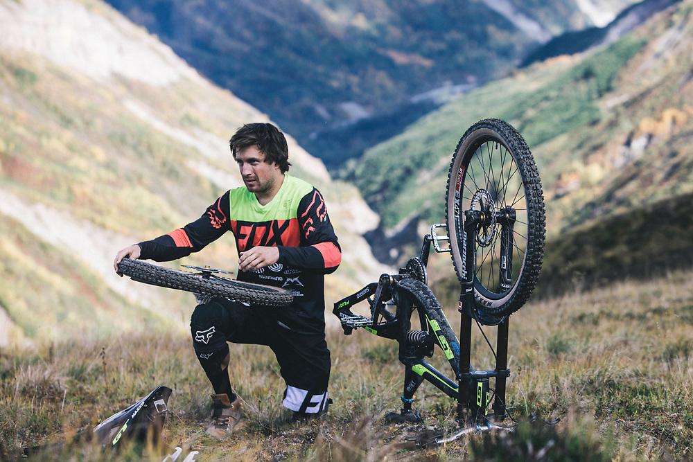 Tyler McCaul works on this bike in the Tatshenshini-Alsek Provincial Park in British Columbia, Canada on September 3, 2016.