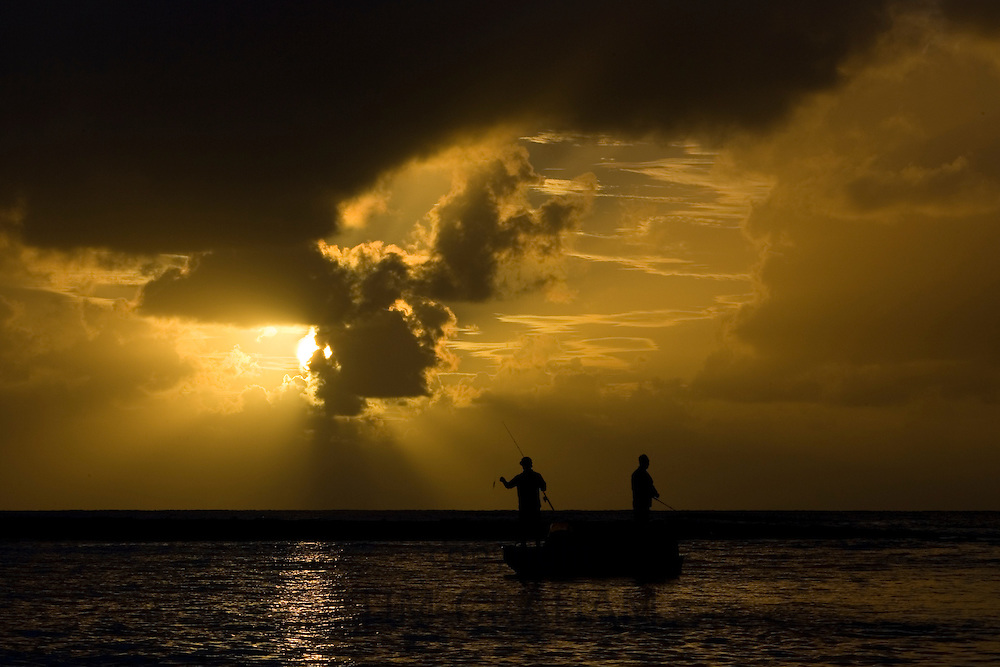 Men fishing at dawn in the Mossman River estuary, Daintree, Australia