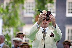© Licensed to London News Pictures. 13/07/ 2013. Competitors take part in the Chap Olympiad 2013 in Bedford Square Gardens, London. The annual  eccentric sporting event, described as 'a celebration of eccentricity and athletic ineptitude' invites participants to take part in events such as the pipeathlon, iron board surfing and umbrella jousting, rewarding panance rather than sporting prowess. Photo credit: Peter Barbe/LNP