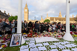© Licensed to London News Pictures. 17/06/2016. Well wishers hold a vigil in Parliament Square in memory of Labour party MP JO COX. She was allegedly attacked and killed by suspect 52 year old Tommy Mair close to Birstall Library near Leeds. London, UK. Photo credit: Ray Tang/LNP