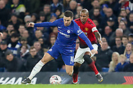 Chelsea Midfielder Eden Hazard battles with Manchester United Midfielder Ashley Young during the The FA Cup 5th round match between Chelsea and Manchester United at Stamford Bridge, London, England on 18 February 2019.