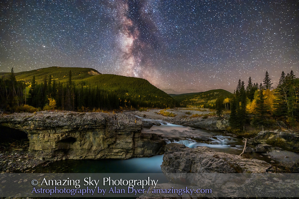 A nightscape scene of the summer Milky Way over the Elbow River and Elbow Falls in the Kananaskis Country in southern Alberta, on a superb autumn evening, with the rising waning Moon beginning to light the hills. Illumination is from starlight and moonlight. <br /> <br /> This is a blend of a single long 6-minute exposure at ISO 800 for the ground with a single short 30-second untracked exposure at ISO 6400 for the sky, all with the 15-35mm RF lens at 15mm and at f/2.8 on the Canon Ra camera. Luminosity masks and dodge & burn layers applied with TK8 Actions. ON1 No Noise AI applied to the sky. A mild Orton Glow added with Luminar AI. Taken September 26, 2021.