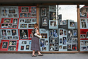 Moscow Russia, 30/07/2011..A woman looks at performance photographs in the window of the Moscow Satire Theatre, which Mikhail Bulgakov renamed the Variety Theatre in his novel The Master And Margarita.