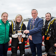 27.07.17.          <br /> Ireland Women's Rugby captain Niamh Briggs was mobbed by young fans in Limerick earlier today (Thursday) as she arrived in the city by boat for the Women's Rugby World Cup trophy tour.<br /> <br /> Pictured are, Ireland Women's Rugby captain Niamh Briggs Karen Keehan, LMSAR, Mayor of Limerick, Cllr Stephen Keary and Mark O'Brien, LMSAR.<br />  <br /> <br /> <br /> <br /> The Limerick based garda and Munster fullback was escorted on the River Shannon by Limerick Marine Search and Rescue along with Nevsail kayakers as she made her way to Arthur's Quay jetty to be officially met by Mayor of Limerick, Cllr Stephen Keary. Picture: Alan Place