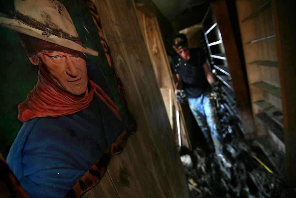 Ricky Killgore (ck) salvages what belongings he can in his trailer in Sabine Pass after Hurricane Ike Saturday September 20, 2008.
