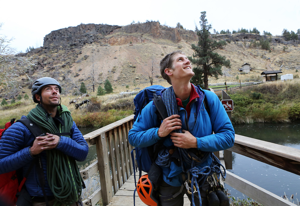 """The film adaptation of Cheryl Strayed's memoir, """"Wild,"""" stars Reese Witherspoon as a troubled woman who challenges herself by hiking the Pacific Crest Trail in Oregon. Mountain guides Billy Haas, left, and Caleb Ladue cross the Crooked River after hiking and climbing on Smith Rock in Terrebonne, Ore. Here they look up at the Monkey Face and the Picnic Lunch Wall they just climbed."""