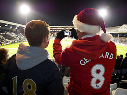 05.12.2011, Craven Cottage Stadion, London, ENG, PL, FC Fulham vs FC Liverpool, 14. Spieltag, im Bild Liverpool supporters take a photograph before the football match of English premier league, 14th round, between FC Fulham and FC Liverpool at Craven Cottage Stadium, London, United Kingdom on 05/12/2011. EXPA Pictures © 2011, PhotoCredit: EXPA/ Sportida/ David Rawcliff..***** ATTENTION - OUT OF ENG, GBR, UK *****