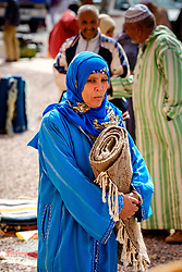 A woman carrying a carpet at the carpet market in in Tazenakht, southern Morocco, Africa<br /> <br /> (c) Andrew Wilson | Edinburgh Elite media