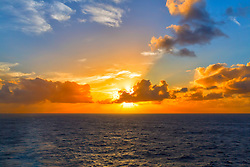A golden sunset on the sea, along the shores of Maui, Hawaii