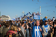 Open top bus surrounded by seagulls during the Brighton & Hove Albion Football Club Promotion Parade at Brighton Seafront, Brighton, East Sussex. United Kingdom on 14 May 2017. Photo by Ellie Hoad.