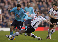 Photo: Olly Greenwood.<br />Fulham v Tottenham Hotspur. The Barclays Premiership. 20/01/2007. Tottenham's Hossam Ghaly tackled by Fulham's Franck Queudrue