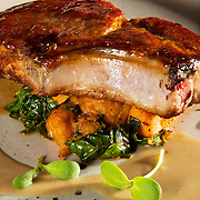 Sorgham Glazed Pork Chop at Piedmont Restaurant in Durham. All the ingredients at the Piedmont come from North Carolina. Nathan Lambrecht/Journal Communications