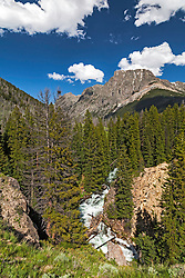 Clear Creek rushing toward to the Green River, Flat top Mountain Towering above.  These alpine gems are in the Wind River Mountains of Wyoming