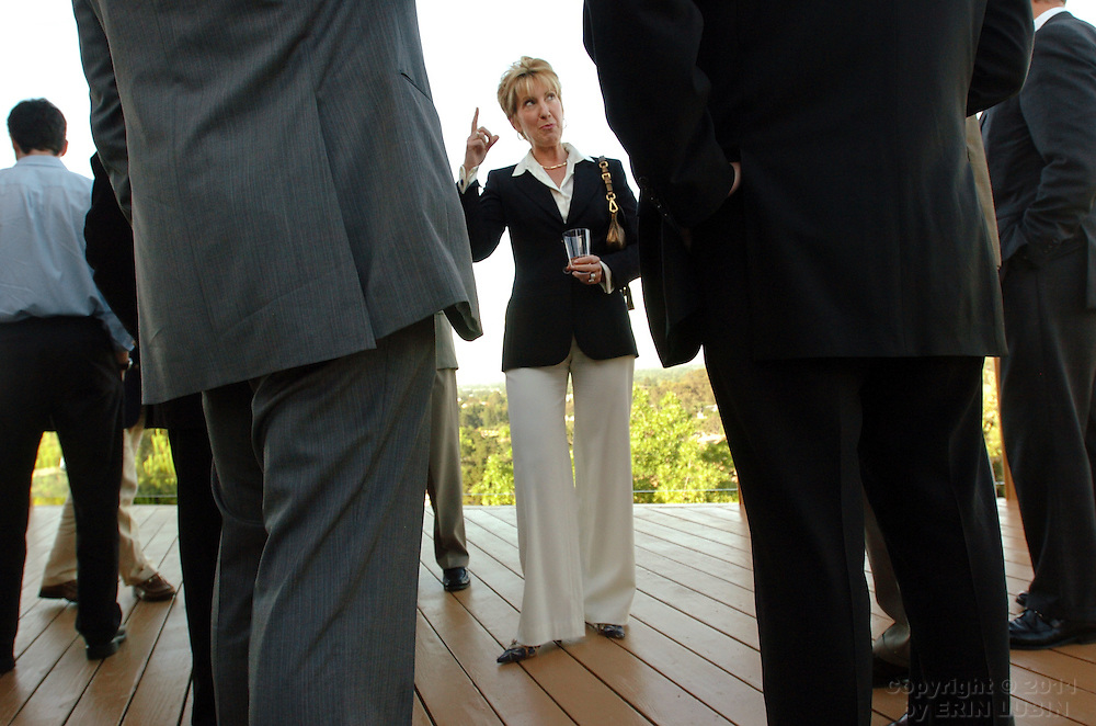 """Carly Fiorina, previously the CEO of Hewlett-Packard, talks with members and guests of Lead 21, a political organization for entrepreneurs, at a private residence in Los Altos Hills Tuesday evening, June 6, 2006. Fiorina is in the midst of publishing a new book titled, """"Tough Choices."""".Event on 06/06/06 in Los Altos Hills...Photograph by Erin Lubin"""