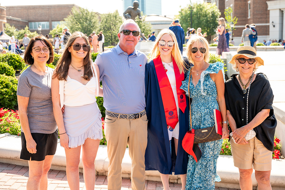 New graduates and their families pose for pictures following the May Commencement Ceremony at Doak Walker Plaza, Saturday, May 15, 2021 on the SMU Campus.