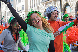 London, March 13th 2016. The annual St Patrick's Day Parade takes place in the Capital with various groups from the Irish community as well as contingents from other ethnicities taking part in a procession from Green Park to Trafalgar Square.  PICTURED: Inline skaters dance along the route of the procession. ©Paul Davey<br /> FOR LICENCING CONTACT: Paul Davey +44 (0) 7966 016 296 paul@pauldaveycreative.co.uk