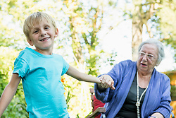 Grandmother and her grandson in the garden