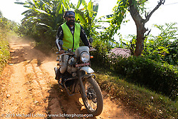 Trip co-leader Buddhi Singh riding a Royal Enfield Himalayan up the last hill in Nuwakot to the Famous Farmhouse on Motorcycle Sherpa's Ride to the Heavens motorcycle adventure in the Himalayas of Nepal. This first day of riding took us from Kathmandu to Nuwakot. Monday, November 4, 2019. Photography ©2019 Michael Lichter.