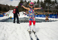 "Jennifer Kelley didn't quite ""go-go"" the distance to cross the pond but she made up for it in ""style"" points for her costume during Gunstock Mountain's BYODC pond skim on Saturday.  (Karen Bobotas/for the Laconia Daily Sun)"