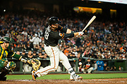 San Francisco Giants catcher Buster Posey (28) hits a foul ball against the Oakland Athletics at AT&T Park in San Francisco, California, on March 30, 2017. (Stan Olszewski/Special to S.F. Examiner)