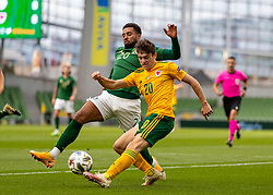 DUBLIN, REPUBLIC OF IRELAND - Sunday, October 11, 2020: Wales' Daniel James (R) and Republic of Ireland's Cyrus Christie during the UEFA Nations League Group Stage League B Group 4 match between Republic of Ireland and Wales at the Aviva Stadium. The game ended in a 0-0 draw. (Pic by David Rawcliffe/Propaganda)
