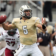 UCF Knights quarterback Blake Bortles (5) passes during an NCAA football game between the South Carolina Gamecocks and the Central Florida Knights at Bright House Networks Stadium on Saturday, September 28, 2013 in Orlando, Florida. (AP Photo/Alex Menendez)