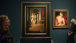 """© Licensed to London News Pictures. 28/02/2019. LONDON, UK. Staff members view (L to R) """"Lover in an Interior"""" before 1497 by Jacometto Veneziano or close follower and """"Saint Sebastian"""" c1533 by Agnolo Bronzino. Preview of """"The Renaissance Nude"""", an exhibition at the Royal Academy of Arts in Piccadilly of 90 works examining the emergence of the nude in European art.  Works by artists including Leonardo da Vinci to Michelangelo are on display in the Sackler Galleries 3 March to 2 June 2019.  Photo credit: Stephen Chung/LNP"""