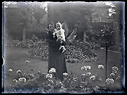 mother with toddler posing in flower garden France circa 1930s