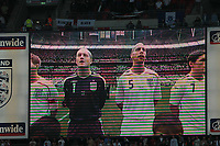 Photo: Tony Oudot.<br /> England v Estonia. UEFA European Championships Qualifying. 13/10/2007.<br /> England players sing along to the national anthem on the big screen
