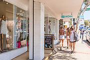 Girls Walking Past Bathing Suit Shop on Coast Highway Laguna Beach