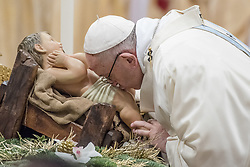 January 1, 2018 - Vatican City, Vatican - Pope Francis kisses a statue of the Divine Infant as he celebrates a new year's Mass in St. Peter's Basilica at the Vatican, Monday, Jan. 1, 2018. (Credit Image: © Massimo Valicchia/NurPhoto via ZUMA Press)