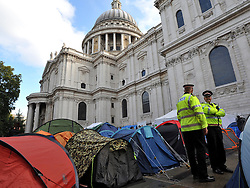 © Licensed to London News Pictures. 26/10/2011. London, UK. Two City of London police officers amongst the tents. Occupy London protesters outside St Paul's Cathedral today, 26 October 2011. The UK's most popular Cathedral still has its doors closed over health and safety fears for it's visitors. Photo: Stephen Simpson/LNP