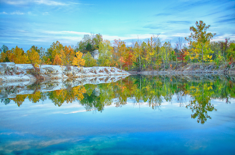 A wonderful mix of colors, the deep blue water and sky, and the bare white rock. Klondike Park, once the site of a silica sand quarry, is a popular destination for outdoor recreationalists, families, and youth activity groups. Trails, both paved and natural, criss-cross the verdant hillsides and offer bicyclists, joggers, and hikers spectacular views of wildlife, native plants, and the surrounding Missouri River Valley.