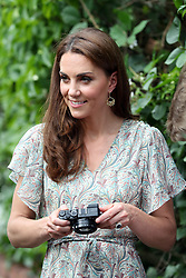 The Duchess of Cambridge during a visit to a Royal Photographic Society workshop with Action for Children which uses photography to help young people develop confidence and self-expression, at Warren Park Children's Centre, Kingston upon Thames.