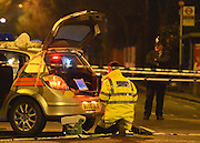 © Licensed to London News Pictures. 17/01/2013. London, UK A traffic officer gather evidence from the rear of the police car involved using a computer. A collision between a police car and a car at the junction of Askew Road and Uxbridge Road in West London on the evening of 17th January 2013. Road closures and diversions were in place. Photo credit : Stephen Simpson/LNP