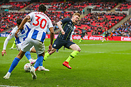 Brighton & Hove Albion forward Alireza Jahanbakhsh (16) performs a tackle on Manchester City midfielder Kevin De Bruyne (17) during the The FA Cup semi-final match between Manchester City and Brighton and Hove Albion at Wembley Stadium, London, England on 6 April 2019.